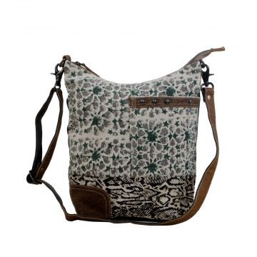 Unconventionally etched shoulder bag